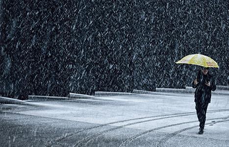 Under yellow umbrella